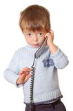 Child talks on the phone Royalty Free Stock Photos
