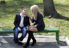 Child talks to the mother in the park Royalty Free Stock Photo