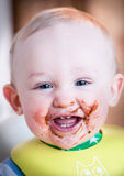 Child tastes dessert for the first time Stock Image