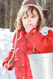 Tasting syrop. Child tasting maple syrup in forest during spring Royalty Free Stock Image