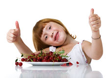 Child with tasty cherry Royalty Free Stock Image