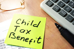 Child tax benefit. Stick with words child tax benefit Stock Image