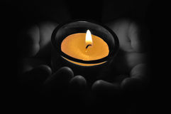 Child with tea light candle Stock Photo