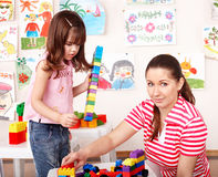 Child and teacher with construction lego . Royalty Free Stock Photos