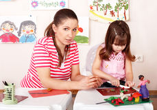 Child and teacher mould from plasticine. Stock Photography