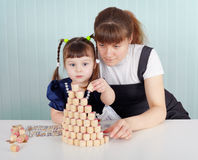 Child and teacher played with lotto Royalty Free Stock Image