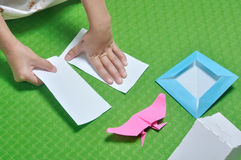 Child tear paper to make origami paper craft Stock Photography