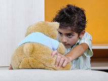 Child and teddy bear Royalty Free Stock Images