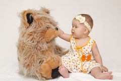 Child with teddy bear Stock Images