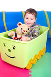 Child with Teddy in the game train Stock Image
