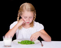 Child or teenager dislikes peas Royalty Free Stock Photography