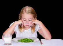 Child or teenager dislikes peas Royalty Free Stock Photos