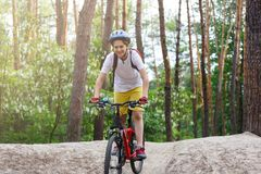 Free Child Teenager In White T Shirt And Yellow Shorts On Bicycle Ride In Forest At Spring Or Summer. Happy Smiling Boy Cycling Stock Photos - 137440343