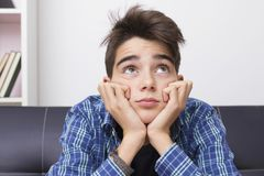 Teenager or preteen with an expression of boredom or tiredness. Child, teenager or preteen with an expression of boredom or tiredness royalty free stock images