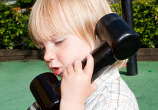 Child telephone playing Stock Photo