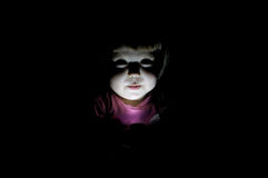 Child telling scary story  in the dark Stock Image