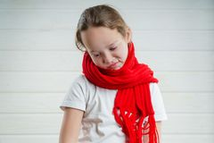 Child temperature. sore throat. bad condition. a child rooting. scarf. Nthe girl is sick royalty free stock images