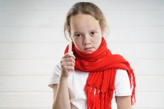 Child temperature. sore throat. bad condition. a child rooting. scarf.  royalty free stock photos
