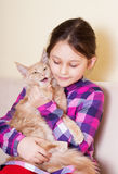 Child tenderly embraces kitten Stock Photography