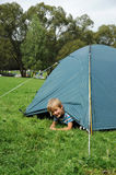 Child in tent Stock Photography