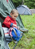 Child in tent in campsite Stock Images