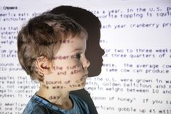 Child an text projection device Stock Photography