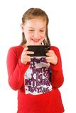 Child texting on a cell phone Royalty Free Stock Photo