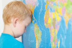 Child think about the world Stock Photo