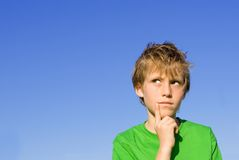 Child thinking Royalty Free Stock Photos