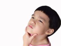 Child thinking. An asian girl toddler thinking hard Royalty Free Stock Photos