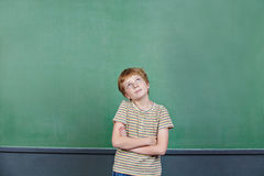 Child thinking in front Royalty Free Stock Photo