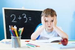 Child thinking about homework solution Royalty Free Stock Photos