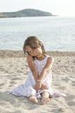 Child thinking on the sand Stock Photos