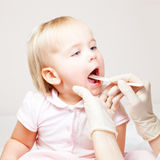 Child throat check Royalty Free Stock Photography