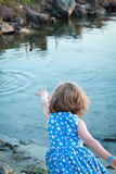 A child throw a stone. Royalty Free Stock Photo