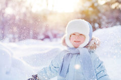 Child throw up snow. Portrait of Child throw up snow royalty free stock images