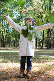 Child throwing leaves Stock Image
