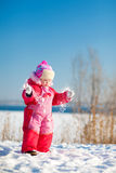 Child throwing snow in winter Royalty Free Stock Images