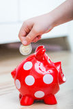 Child thrown into Piggy coin Royalty Free Stock Image