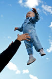 Child thrown up in the air stock image