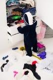Child throws clothes Stock Photo