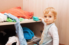 Child throws clothes Stock Photo