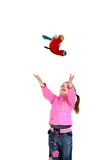 Child throws up toy. White background Royalty Free Stock Photography