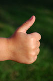 Child thumb up Royalty Free Stock Photography