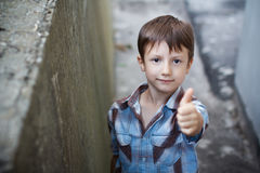 Child thumb up outdoor Stock Images