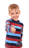 Smiling child with thumbs up sign, isolated on white Royalty Free Stock Photos