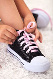 Child ties shoe - closeup Royalty Free Stock Photo