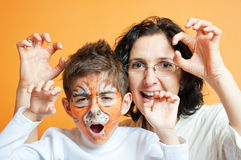 Child in tiger make-up and mother Royalty Free Stock Image