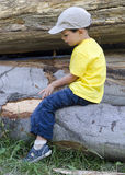 Child on timber logs Royalty Free Stock Photo