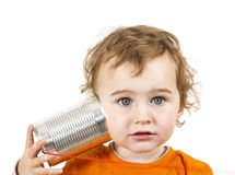 Child with tin can phone looking to camera Stock Photography